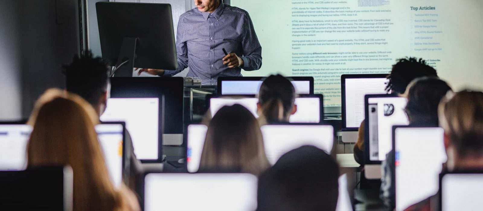 students on their computers at school